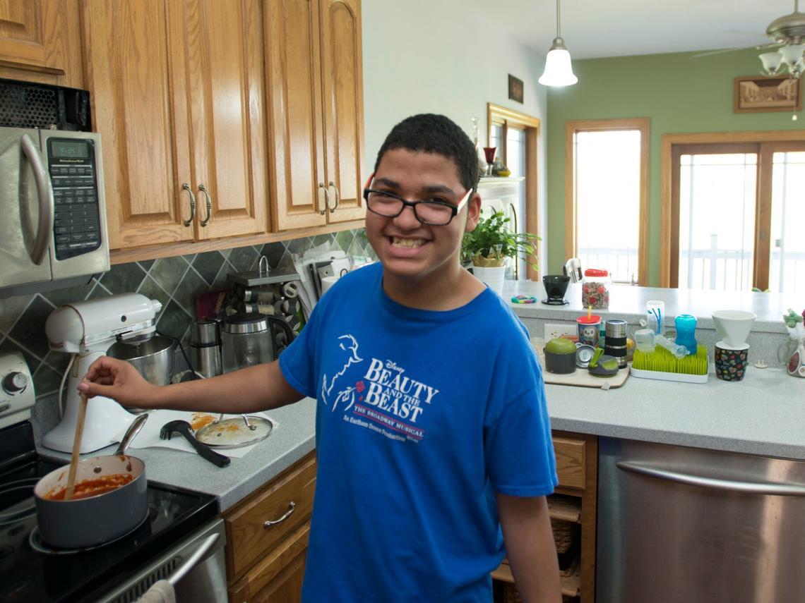 Teen boy cooking