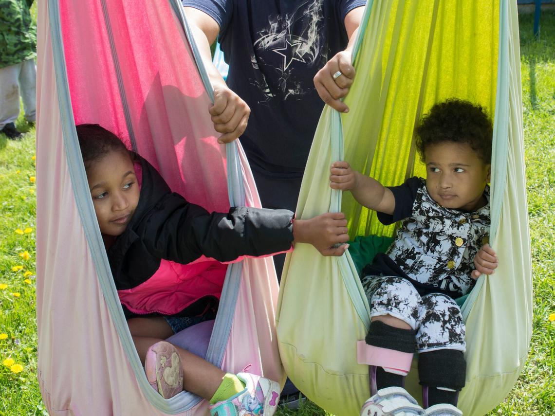 Two young girls in hammock swings